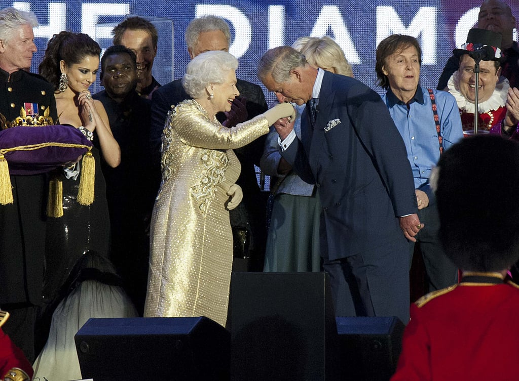 Prince Charles kissed the queen's hand at the Diamond Jubilee Concert at Buckingham Palace.
