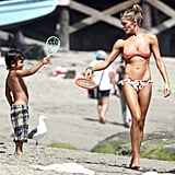 LeAnn played with her stepson on the sand.