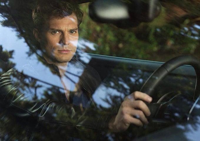 Jamie Dornan as Christian Grey.