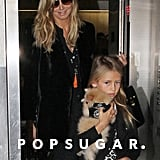 Heidi Klum and her daughter Leni Samuel arrived at LAX with a puppy.