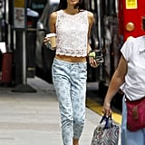 Even though Amal bared her midriff for an off-duty look, she stuck with a floral theme — from her sunglasses to her jeans.