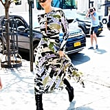 In May, the 22-year-old star stepped out in a colorful Longchamp dress, which she wore with black boots and sunglasses.