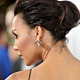 When Naya pulls her hair up, a little bow is exposed to the world.
