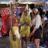 Naomi wears a short skirt and oversize hat for a sexy take on a pirate getup, while Holly has a person dressed as a banana in tow to complement her tropical headdress.  Photos courtesy of CW