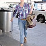 Reese Witherspoon caught a flight at LAX on Monday.