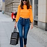 Skinny jeans and a brightly colored sweater is a great pop of something classic yet head-turning at the same time.