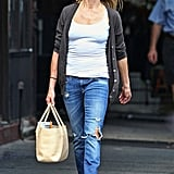 Cameron Diaz wears a tank top and cardigan.