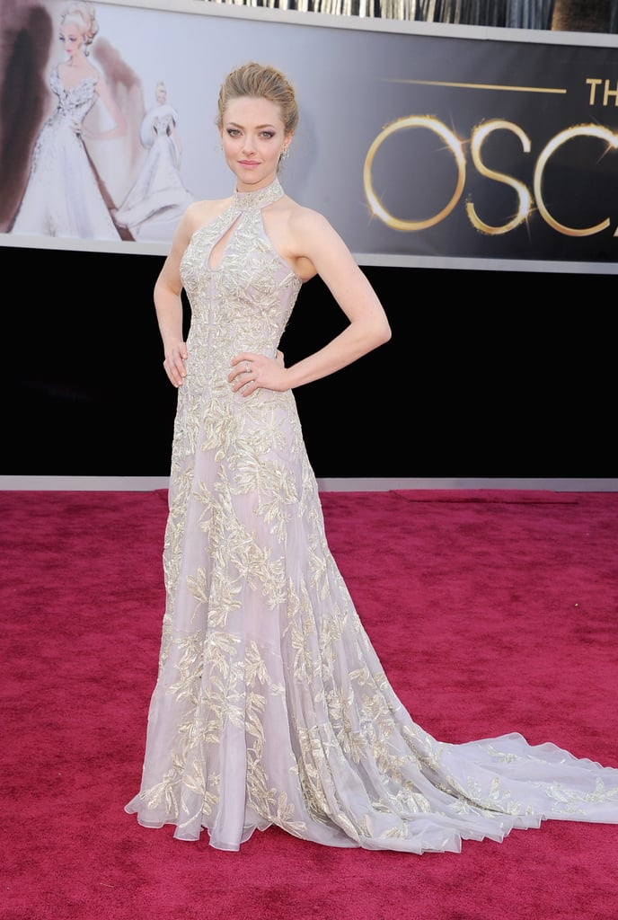 Amanda Seyfried continued her string of elegant red carpet ensembles with her Alexander McQueen look today in LA at the Oscars. She told Ryan Seacrest that McQueen was working on the special dress for her for months. Amanda's not in the running for any individual awards, but her film Les Miserables is up for best picture against Argo, Life of Pi, Django Unchained, Silver Linings Playbook, Beasts of the Southern Wild, Lincoln, Zero Dark Thirty and Amour. She's showing support for Anne Hathaway, best supporting actress nominee, and Hugh Jackman, who's up for best actor, as well. She'll also be performing with her cast. What do you make of Amanda's look on the carpet? Be sure to weigh in on all of our Oscars fashion and beauty polls.