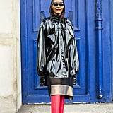 Supersize the effect by wearing your PVC coat with tall boots.