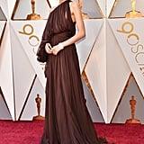 During the 2018 Oscars, Zendaya wore a one-shouldered Giambattista Valli gown.