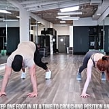 Start in a push-up position and step both feet in, one at a time, then back out, one at a time. Repeat eight times.