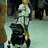 Kate Hudson holds onto Bing at the airport.