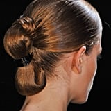 The hair at Stéphane Rolland was a remix of the average ponytail. The ends were tied off and tucked under.