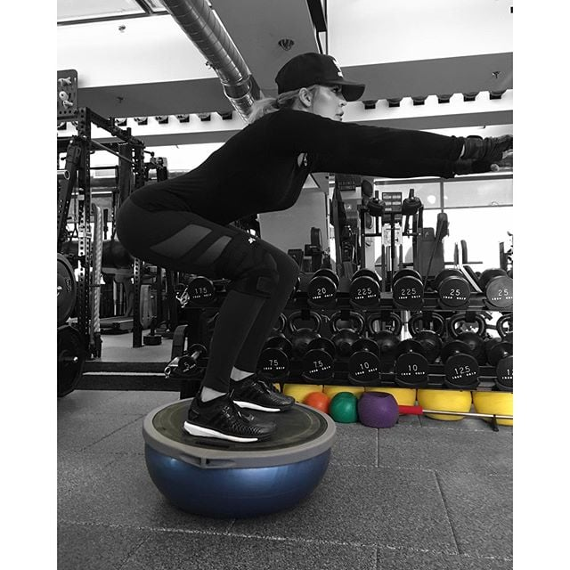 Khloé knows static squats on a Bosu ball make them way more intense.