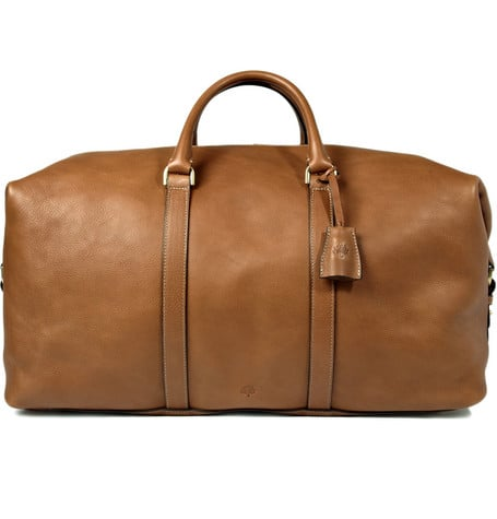 I am such a bag man — it's a little bit of a problem. I have been looking for an investment travel bag, and I can see myself carrying the Mulberry clipper ($2,100) now and 20 years from now. It's the perfect size, it's the perfect color, it's lined in suede — which you almost never see anymore — and it has a detachable shoulder strap. This is it.  