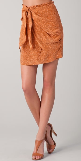 We love the twist-front detail on this printed silk skirt.  Club Monaco Addie Skirt ($140)