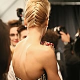 """It's Badgley Mischka, so we're dressing hair,"" said lead stylist Peter Gray for Moroccanoil. The braided updo was inspired by Kim Novak from The Birds."
