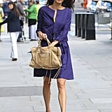 Amal let her jewel-tone separates take center stage with a neutral bag and flats.