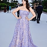 Posing next to the sunset in a strapless lavender gown by Elie Saab.