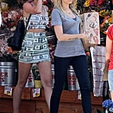Miley's casual-cool Trader Joe's attire was straight money, literally.
