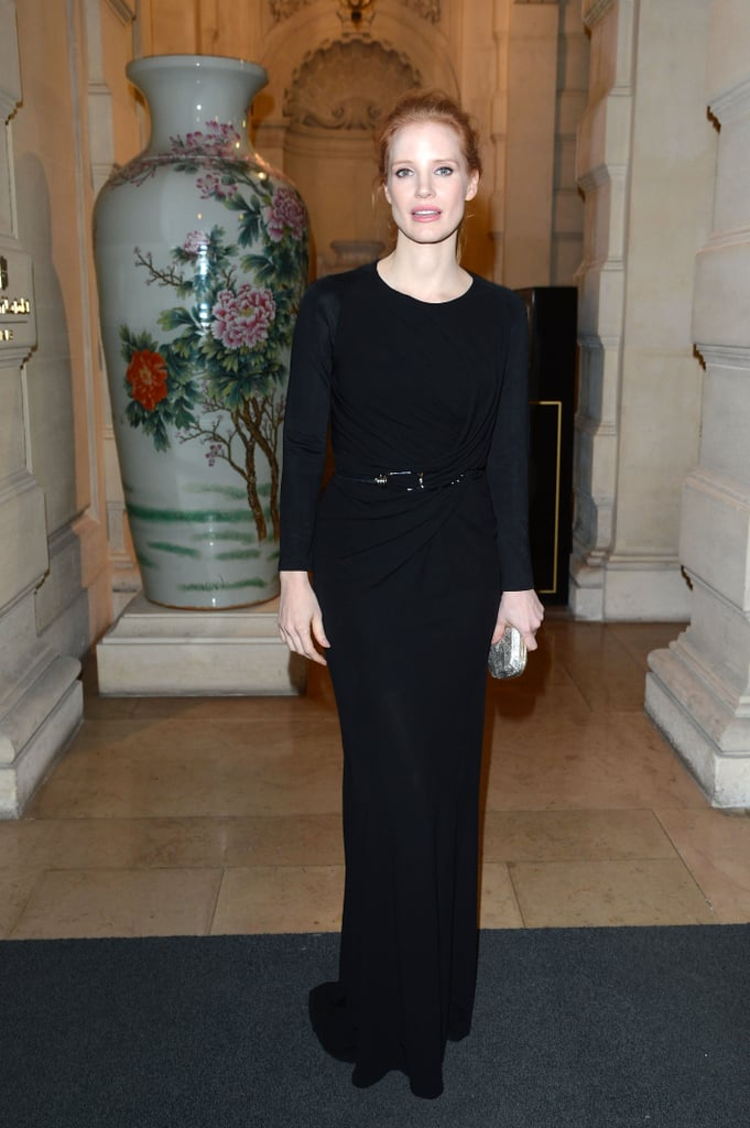 Jessica Chastain wore a long black dress with sheer sleeves to CR Fashion Book's launch party on Tuesday in Paris.