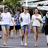 Erin Andrews, Brooklyn Decker, and Chrissy Teigen went for a stroll in Australia all wearing white tops and denim shorts.