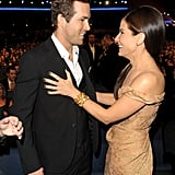 Longtime friends Ryan Reynolds and Sandra Bullock shared a laugh together in 2010.