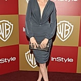 Kelly Rutherford slipped into a slinky gray cocktail dress and paired it with a metallic clutch and nude pumps.