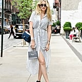 On the streets of the NY neighbourhood of SoHo, Gigi slipped into a breezy Reformation dress and Chanel booties.
