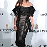 Julia Restoin Roifeld put her shoulders on display in a black lace Dolce & Gabbana number at the de Grisogono party.