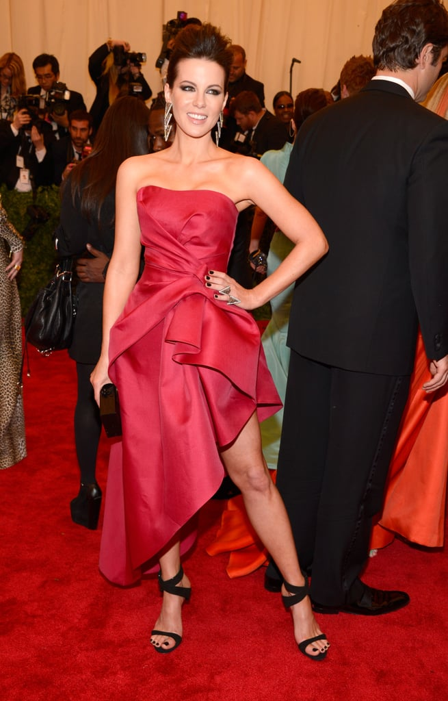 Kate Beckinsale was decked out in a pink Alberta Ferretti dress that showed off her sky-high heels at the Met Gala in NYC this evening. The gown had a high hem in the front, while it was long in the back, which meant it also put her perfectly toned stems on display. Kate was without her usual date, husband Len Wiseman, but she had plenty of fellow fashionable stars to rub elbows with all night long.  Check out all the fashion from the night and weigh in with our live Met Gala fashion and beauty polls now!