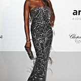 Naomi Campbell opted for a gray fitted strapless L'Wren Scott gown — don't miss the protruding feathers!
