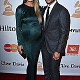 In a green Galvan gown, Chrissy attended a pre-Grammys party with John.
