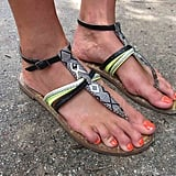 There's not much to these T-strap sandals, but what is there — a great woven print plus a pop of neon green — makes these flats a statement piece.