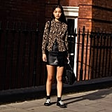 A printed blouse and leather skirt are perfect for date night.