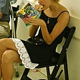 A model grabbed a bite to eat while reading ahead of Rebecca Taylor's Spring 2006 show in New York City.