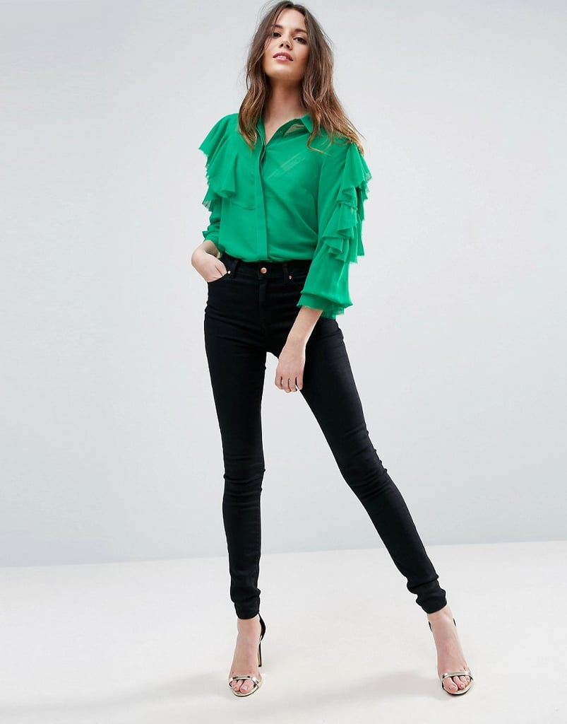 This button-up ruffle blouse ($55) is the perfect going-out top to wear with jeans.
