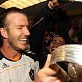 David Beckham held up the 2011 MLS Cup in his loccer room.
