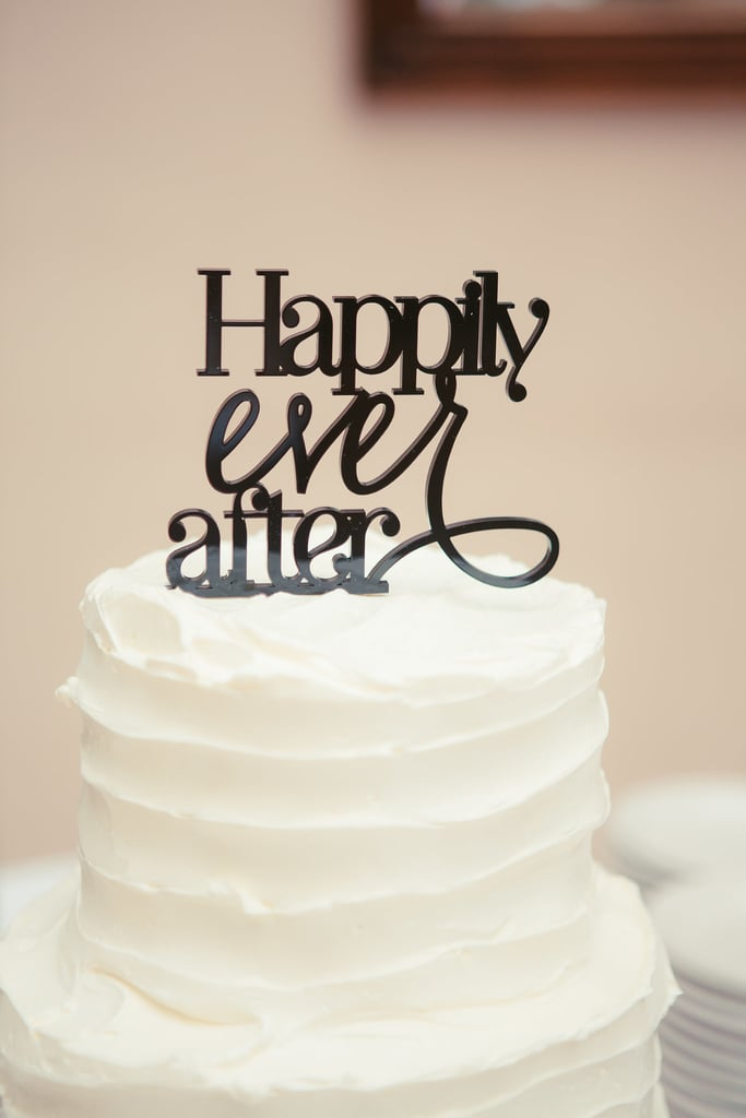 "Here, less is more: rustically frosted and topped with a black ""Happily ever after,"" this cake is sleek and sophisticated.."