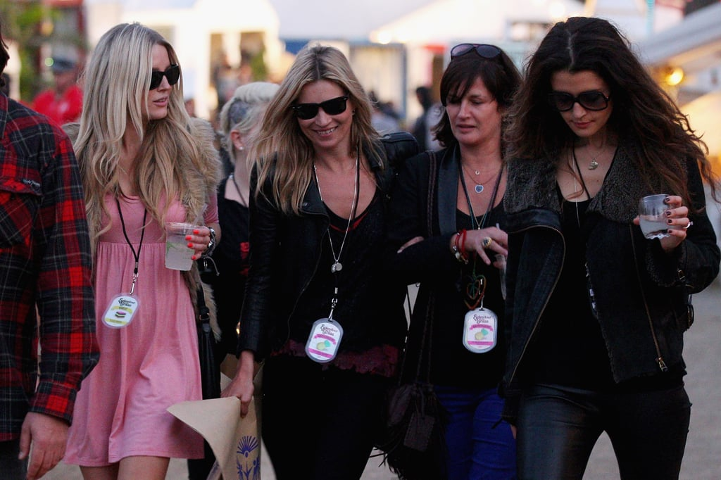 Kate Moss was at the Splendour in the Grass festival in Queensland, Australia, today to watch her husband, Jamie Hince, take the stage with The Kills. Following his set, she ventured over to the shopping area, and she left with a bag full of goodies from the shop Tree of Life. She and Jamie have been in Australia for one week as he tours down under. They're due for a weekend show in Japan, then are heading to the US for more dates. Kate made the rounds this afternoon with pals like TV presenter Kylie Speer. Gwyneth Paltrow is rumored to arrive tomorrow to check out her spouse, Chris Martin, as he takes the stage with Coldplay. First up, though, will be Kayne West this evening, and Kate and Jamie are apparently sticking around to watch his antics.