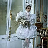 Dolled up in a luxe wedding gown creation for the YSL Fall couture show in 1981.