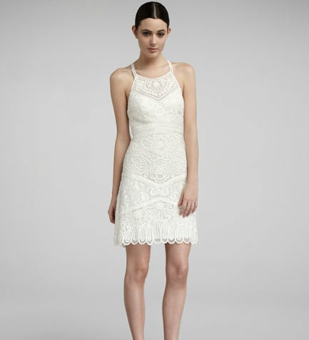 This sweet lace dress would be ideal for an understated nuptial or perfect for a rehearsal dinner.  Sue Wong Embroidered High-Neck Dress ($370)