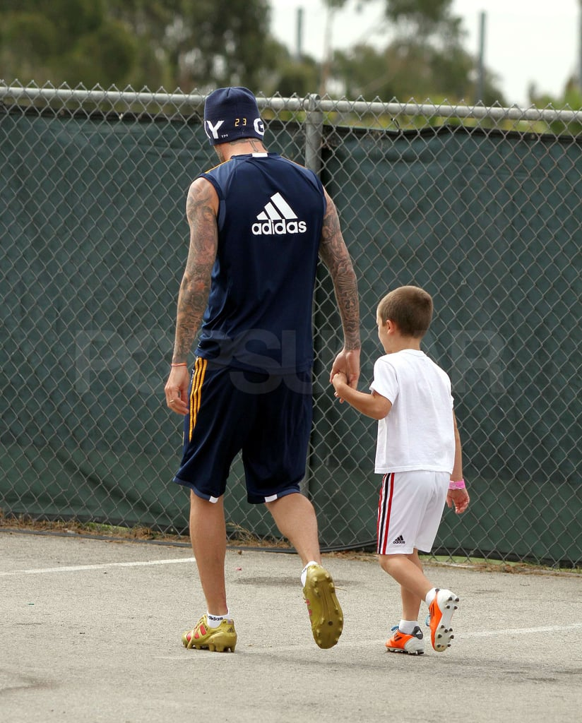 David Beckham held hands with Cruz Beckham.