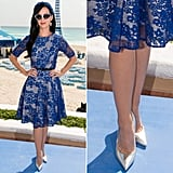 Katy Perry flew to Cancun to get in on the Smurfs 2 fun wearing a fitting blue lace Dolce & Gabbana fit-and-flare dress with silver metallic pointy Jimmy Choo pumps. Her blue accessories — a floral Alice band printed cat-eye sunglasses — added additional flair.