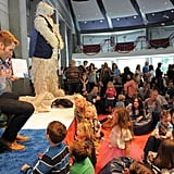 Chris Pine showed his book to the kids as he read to them.