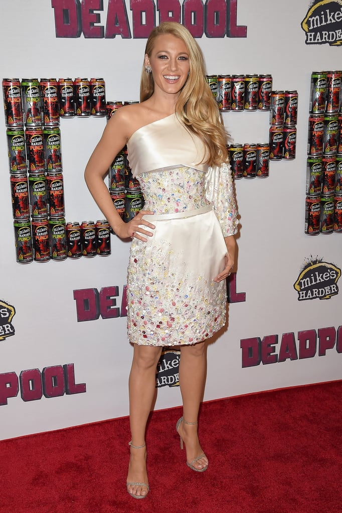 Wearing a one-shoulder embellished dress to a 2016 Deadpool fan event.