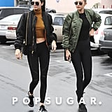 The duo's coordinated style looked extra cool with laid-back sneakers and sunglasses, despite the inclement weather.