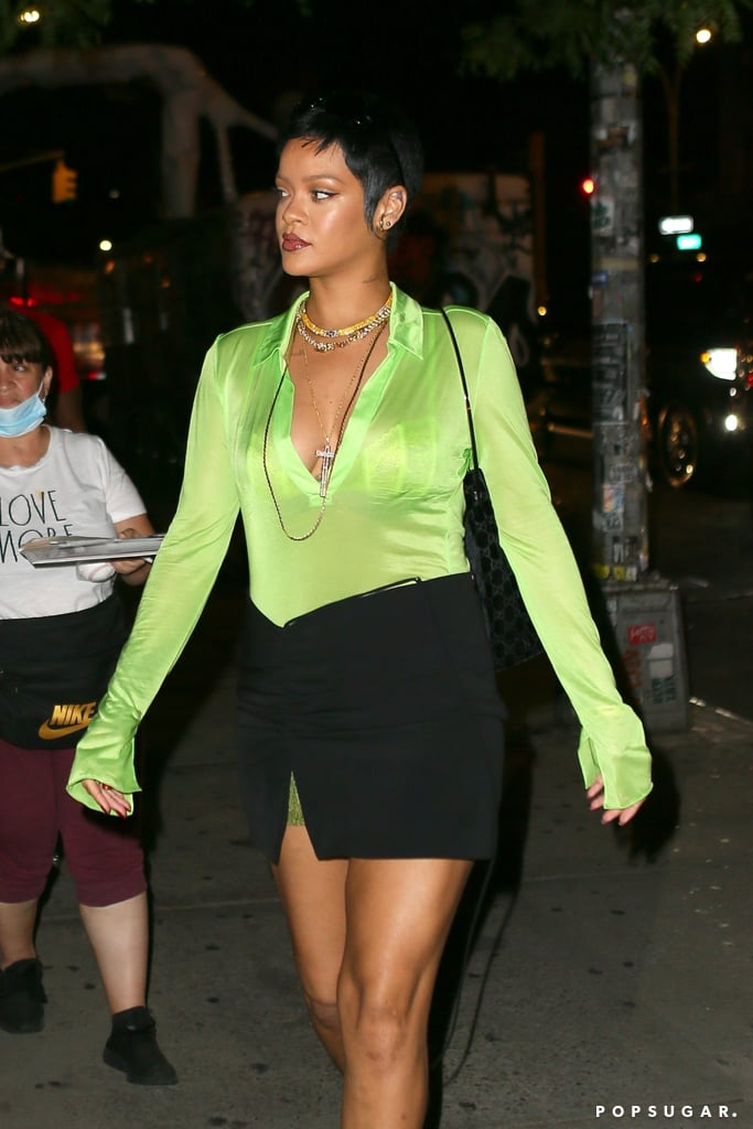 We have to hand it to Rihanna here, 'cause even in almost-100 degree heat and humidity, she managed to put together not just any outfit, but a chic one at that. While heading to dinner in New York City on Monday, the multi-hyphenate turned heads in a sheer lime green button down tucked into a tiny miniskirt with green sequin detailing, both from Supriya Lele, giving us yet another leggy moment. The see-through top also revealed what looks to be Savage x Fenty lingerie, because duh. Rihanna accessorised with a vintage Tom Ford for Gucci velvet shoulder bag, layered necklaces, and crystal-embellished, camouflage print pumps to complete her effortless street style look. And paired with return of her new pixie cut, the star looks like she stepped straight out of the 2000s. Ahead, admire her glamorous outfit in its entirety.      Related:                                                                                                           Gigi Hadid's Mom Confirms She's Going to Be a Grandma Come September!