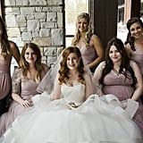 These bridesmaids all wore the same style of a dusty-rose colored dress.