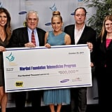 Jennifer Lopez posed with a $500,000 check for the Maribel Foundation.